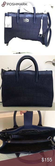 DVF Embossed Gallery Viviana Leather Tote Brand NWT comes  with dust bag. Navy crocodile effect nu buck leather Signature logo-engraved black resin. Twist to lock, 2 compartments 2 zip pockets, 4 pocket slot, front and back slip pocket. Detachable and adjustable shoulder strap. Dimensions: SH L 9.5 in x W 13.2 in x D 5in Handle drop 3.6 in Min strap drop length 19.5 in Max strap drop length 23 in Diane Von Furstenberg Bags