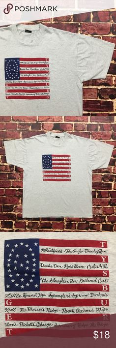 Vintage USA Flag Tee Gettysburg America Shirt Vintage 90s Gettysburg USA Flag Shirt Mens Size L/XL in Gray  Overall Great Shape! Super soft cotton/poly fabric. Graphic is in great shape, shows minimal wear. Made in USA. Mens Size XL. See photos for exact measurements.  See Photos.  Plenty of other items for sale & always listing more! Be sure to check out my store & give me a follow Fruit of the Loom Shirts Tees - Short Sleeve