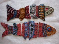FISH in ceramic clay by Gail Laughlin, ready to be wired and hung.