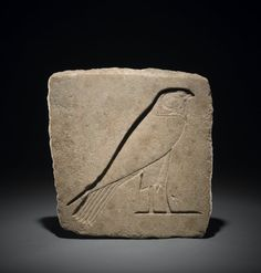 Quartzite trial-piece; a sunk relief representation of a falcon. XXVIth dynasty. Memphis - Mit Rahina. British Museum.