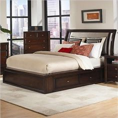 this is a low profile bed with drawers down below.dark brown strong and steady.