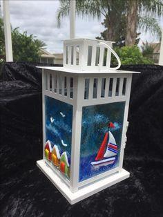"Work by Annie Dotzauer. ""By the Sea"" fused glass lantern."