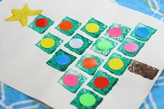 We love easy Christmas crafts for kids! This shape Christmas tree sponge painting is a fun way to combine art and learning!