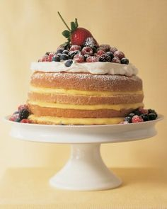 A classic lemon cake layered with sweetened whipped cream and topped with fresh berries.