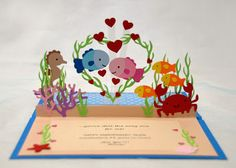Create A Critter Cricut cartridge to cut all the fish and sea creatures, and Life's A Beach cartridge for the seaweed and coral.