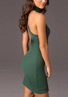 Right side view of model in dark green cross-back bodycon dress