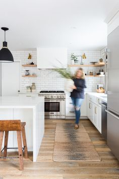 Beautiful all white kitchen remodel with wood floors, wood stools and wood open shelving against all white cabinetry and counters. Love the hidden range hood! Walnut Kitchen, Teal Kitchen, All White Kitchen, Eclectic Kitchen, Kitchen Colors, Kitchen Decor, Kitchen Design, Kitchen Ideas, Sycamore House