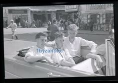 Rare original Asian negative of Sai Wan Hong Kong 1959, showing RAF British boys RAF cadets cruising in a vintage open topped  car, shows local shops street scene , wonderful quality one off image, you will be buying exclusive rights and copyright. Comes from RAF cadet collection 1959 -1960 Sai Wan base Hong Kong China.for sale on ebay uk 24th June 2019 seller 1byzantine