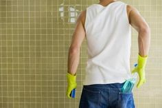 Showers can be cleaned without the use of harmful chemicals. Mix 1/4  borax + 1 c white vinegar in a spray bottle. Apply the mixture to the shower wall and allow it to sit for up to one hour while the mixture penetrates the tile grout and stains. Wipe off the mixture with a clean rag.