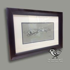 Here we have a lovely pastel drawing of two greyhounds with a wonderful sense of movement to it. We've used a double mount and classic black wooden frame to give a bold and unfussy look that sets off the subtle monochrome colour of the piece.