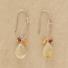 "QUARTZ PENDULUM EARRINGS -- Elongated hoops harness a dangling trio of garnet, carnelian and pendulous rutilated quartz. Sundance exclusive handcrafted in USA of sterling silver. Approx. 1-3/4""L."