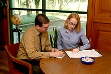 Man and woman wearing business casual work on a project together - Copyright iStockphoto / Xploresoft, LLC