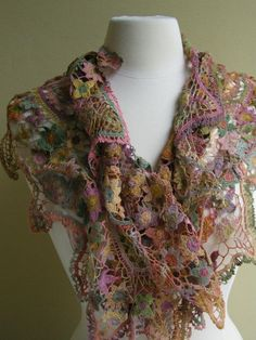This Royale hand crocheted scarf by Sophie Digard is in a burst of bright linen colors with warm pastels dominating