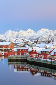 Red homes are typical to this area in Norway, and look especially quaint reflected in the water below them.