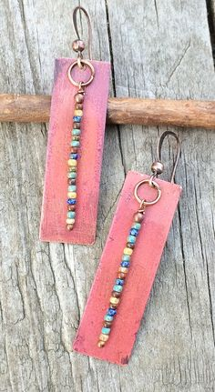 Copper earrings with an oxidized finished and rustic colorful seed beads. These earrings are very light weight and hang about 2 in length. The length can be adjusted upon request. To view more of my handmade jewelry, please visit: https://www.etsy.com/shop/rusticajewelry