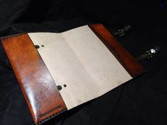 Leather Zelda Triforce cover. Use it on your journal, a book your currently reading, sketch book, day planner. Etc.  Each one made will be similar to the one pictured. No two are exactly the same due to each one being made by hand.  A mixture of saddle tan and medium brown dyes give it that old and worn out look. Hand tooled and painted by artist Ian Finch-Field of Skinznhydez Small: Fits 5.5 x 8.5 or less Actual size: 9 x 6.25  Large: Perfect fit for The Hyrule Historia book. 12.25 x 9.25 x…