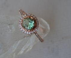 Rose Gold Halo Ring With Merelani Mint Garnet and Diamonds. via Etsy.