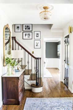 Benjamin Moore Classic Gray A house tour of a 1960 colonial 1 year after improvements with room makeover before and afters. Decor, Paint Colors For Home, Home, Perfect Gallery Wall, House, Living Room Remodel, New Homes, Home Remodeling, Hallway Decorating