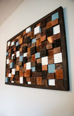 This is a beautifully handcrafted wall art piece that is made entirely out of reclaimed wood and barn wood! Each individual piece is cut a different size giving it that amazing 3D look to go! Also, each piece of wood is stained and/or painted its own color giving it a great contrast of colors that can go perfectly in ANY room! This piece is truly beautiful and is a conversation starter for sure. It literally adds such a cool feel to any room. Dimensions of this piece are 4ft long and…