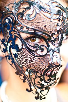 no idea where this is from, but lace metal half mask is neat