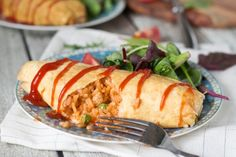 Omurice is a classic Japanese dish consisting of ketchup flavored rice cooked together with chicken and peas, and wrapped in a thin omelette. Kids love it!