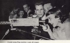 Co-ed checks out a machine gun at the 1951 Military Ball. From the 1952 Oregana (University of Oregon yearbook). www.CampusAttic.com