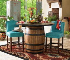 Former Pinner : This bar table would be perfect for The Shed - I wish it wasn't so pricey!  $1399.00    The barrel could be found for $30 and with a top made from something recycled  the two (or more) appropriate chairs could be found and recycled with paint and new DIY upholstery.