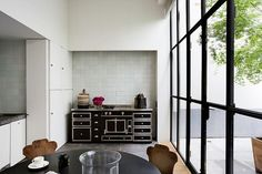 old range, open kitchen, windows, white tile, simple