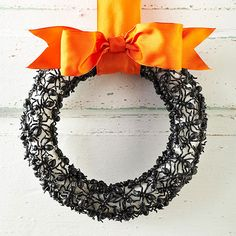 Decorate on a dime with this Halloween-wreath DIY: http://www.bhg.com/halloween/crafts/cheap-halloween-crafts/?socsrc=bhgpin101914sophisticatedswarmwreath&page=6
