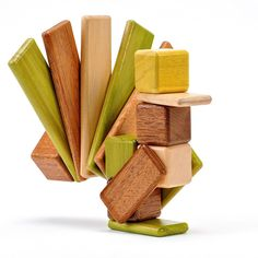 Jungle themed wooden blocks that have internal magnets making them too cool for school. I want them!!