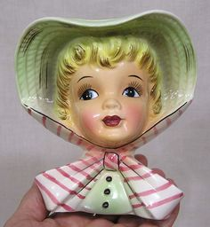 """Elegant lady wearing a green bonnet tied down with a pink striped scarf. She is 6"""" in height. Stamped Samson Imports 417A 1959. There are two tiny fleabite nicks on the inner edge of her hat as shown here.   eBay!"""