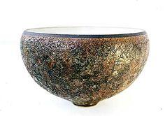Ceramics by Deirdre Burnett at Studiopottery.co.uk - Thrown bell bowl, matt white inside, lava lace out. H: 9cm, D: 16cm.