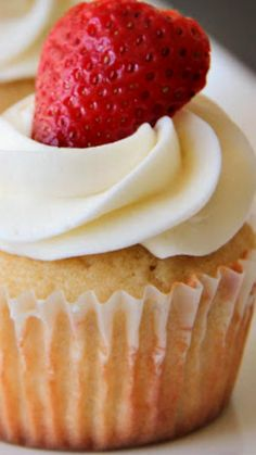 Perfect Vanilla Cupcakes with Vanilla Buttercream ~ These cupcakes are light and moist and perfect for any occasion!