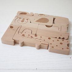 Petit Collage wooden Safari Puzzle + Play, via littlegoldieshop's Instagram.