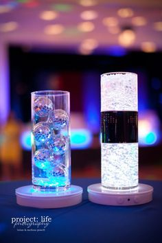 70s Centerpiece Decorations | Disco balls and LED lighted gel gave a little sparkle throughout the ...