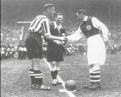 Sheffield United Captain Harry Cooper with Alex James of Arsenal ahead of the 1936 FA Cup Final
