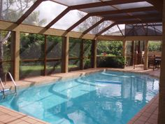 Pool Enclosures Design Ideas, Pictures, Remodel, and Decor - page 25 Pool Screen Enclosure, Screen Enclosures, Pool Enclosures, Outdoor Entertaining, Beams, Swimming Pools, Indoor Pools, Patio, Pool Ideas