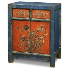 Floral Motif Tibetan Cabinet. A timeless centerpiece, this chest eloquently manifests the expressive art style of the Tibetan people. Tibetan furniture.