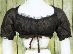 Ball gown bodice c. 1800 made of black China silk. Trimmed with fine black…