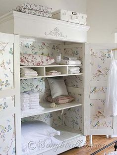 Wardrobe Makeover - love the wallpaper on the door panels and interior - so pretty!!!