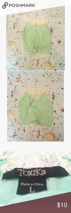 🐚Mint colored tie top🐚 🐚 this top is lightly used and in great condition. It's a mint color and ties in the front.  It's shorter in length and has a hint of lace. It's a size large but fits like a small/medium🐚 Tops