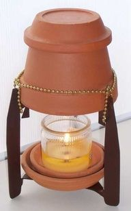 candle heater made from nested ceramic pots...serves as light and a small form of heat.