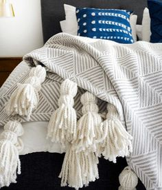 DIY Tassel Throw Blanket | Learn how to make tassels for any blanket with this DIY project.