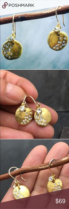 """Handmade gold circle earrings with crystals Handmade circle gold earrings with Swarovski crystals. A signature style earrings. Organic formed circles. Acrylic with 24k gold leaf and pave with Swarovski crystals. Hanging on a 14k gold fill hook and a limitless tiny Crystal hanging to ad a cute little detail. These are super light weight and easy to match with anything.  Please note they will vary slightly in shape since each is made by hand so no too are exactly the same. Length about 1"""" or…"""