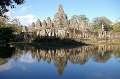 The Bayon Temple, the latest add to the Angkor Complex in the late century. Looking like piles of rubble from a distance but closer look reveals 200 serene buddha faces carved in stone looking in all directions. Buddha Face, Angkor Wat, 12th Century, Monument Valley, Serenity, New York Skyline, Travel Destinations, Beautiful Places, Places To Visit