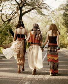 Modern hippies with boho maxi skirts in tribal inspired prints for a gypsy chic look. For the BEST Bohemian fashion trends FOLLOW https://www.pinterest.com/happygolicky/the-best-boho-chic-fashion-bohemian-jewelry-gypsy-/ now