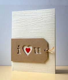 handmade Valentine card ... woodgrain embossed background ... kraft tag with negative space letters: i (heart shape) u ... clean and simple ... graphic look ... great card!!