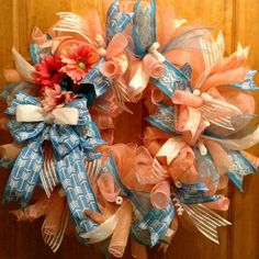Pink and blue deco mesh wreath with floral accents.