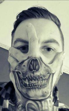 Hand skull face tattoo