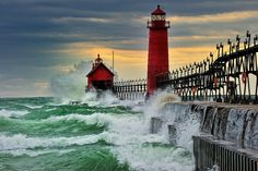"""""""September Gale"""" Grand Haven. Breakwater Lighthouse is located in the harbor of Grand Haven, Michigan. #ocean #Michigan #landscape #storm #waves"""